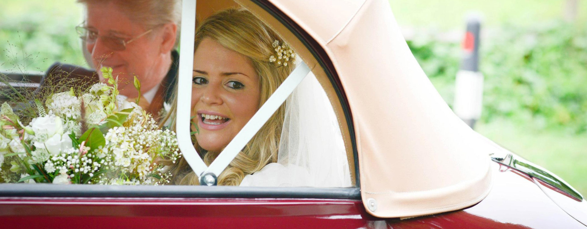 Bride in our Morris Minor wedding car