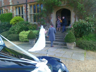 Bride and groom arrive at Horsted Place